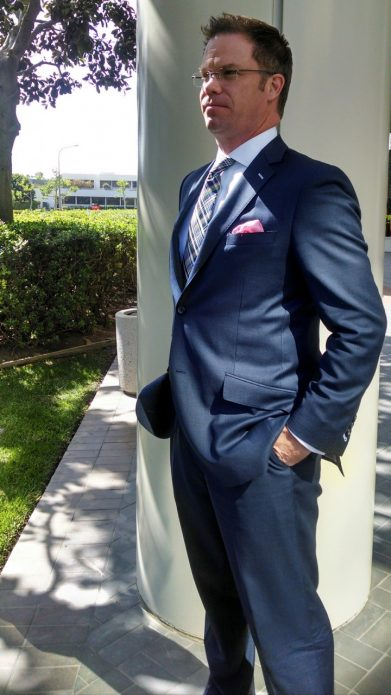 Brad J. Otto models his newest John Bradley Custom Clothier designer suit for his exclusive clientele.