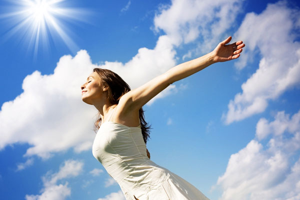 Beautiful Woman Enjoying Sunshine & Blue Sky